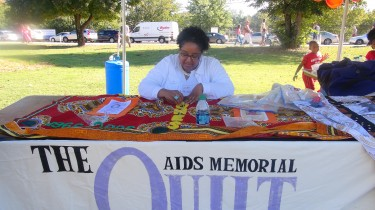 The Creation of the AIDS Memorial Quilt Being Made on the Spot at the AIDS Walk Event (C) 2013